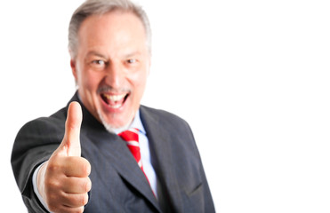 Mature businessman thumbs up