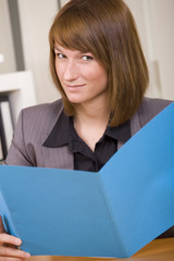 woman reading application file
