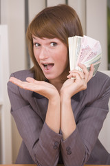 woman with stack of money