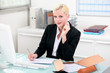 Blonde woman working at her desk