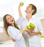 Fototapety Happy Couple Eating fruits. Healthy eating. Diet