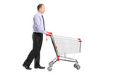 Full length portrait of a man pushing an empty shopping cart