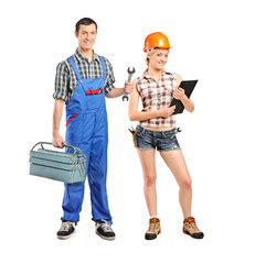 Full length portrait of a male and female manual workers