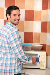 Man using microwave