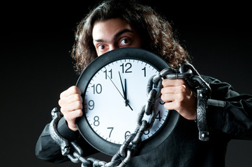Man chained to the clock