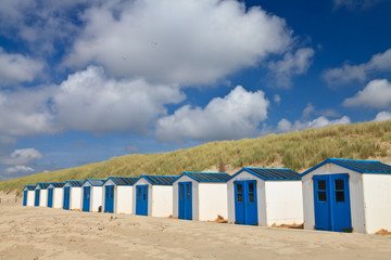 A row of cabins on the beach