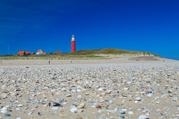 Seaside with sand dunes and  lighthouse