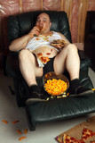 Hamburger eating lazy couch potato poster