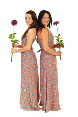 Full length of beautiful women with flowers