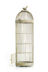 Vintage bird cage with open door over white background.