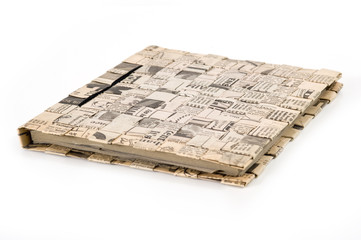 Diary book on white background. Cover made by old newspaper.