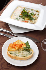 fish soup with potato chips and fish pie