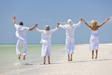 Four People, Two Seniors, Family Couples, Jumping On Beach