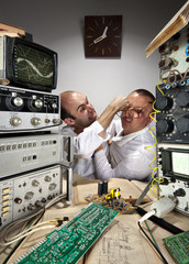 wo funny scientists fighting at laboratory