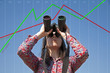 Woman with binoculars and stock market scale
