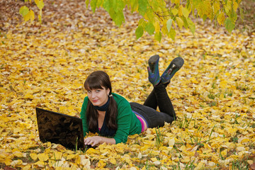 beautiful girl with a yellow autumn foliage