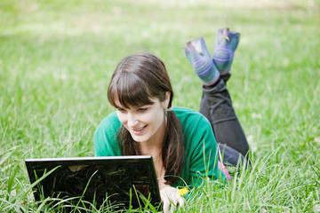 girl with a laptop in the grass