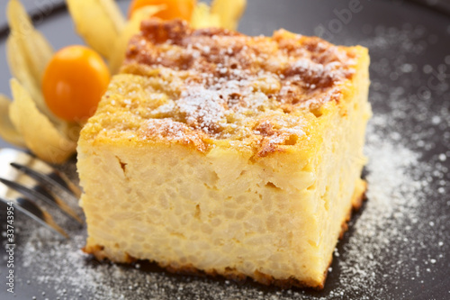 Baked rice pudding dessert sweetened with sugar powder