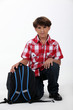 Little boy with a satchel, studio shot