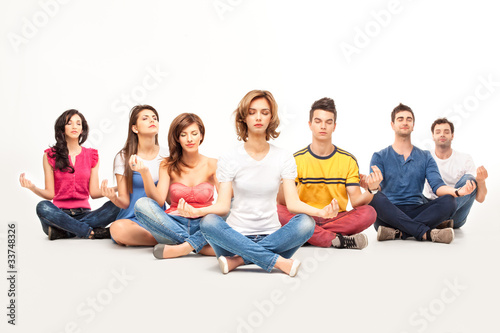 young casual people at yoga course