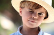 Closeup of a young boy in a straw hat