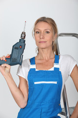 Woman posing with power drill