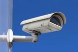 white CCTV camera under blue sky poster