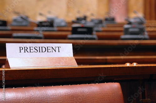 empty president seat in conference hall