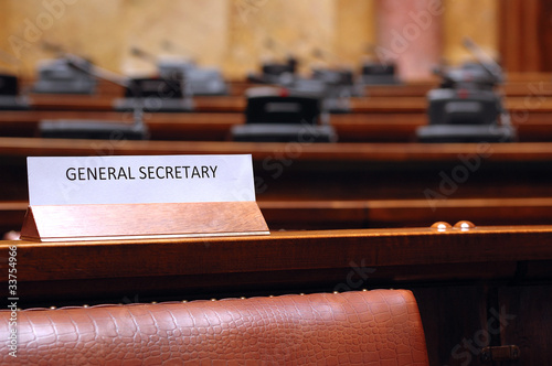 empty General Secretary seat in conference hall