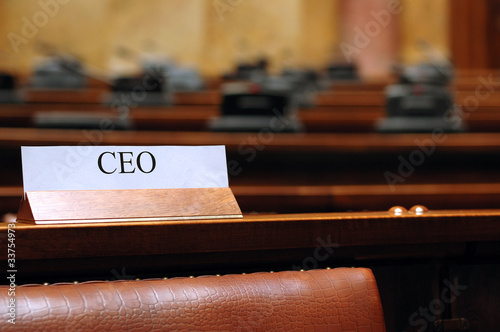 empty CEO seat in conference hall