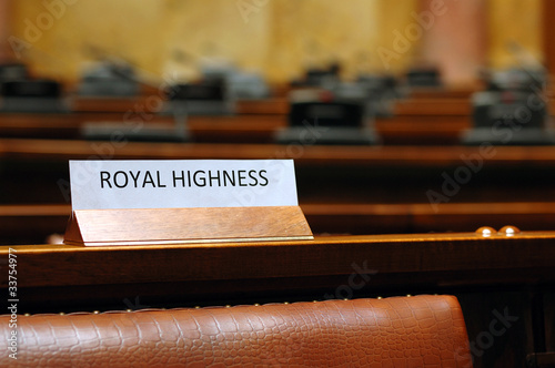 empty Royal Highness seat in conference hall