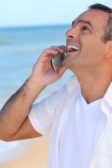 Mature man laughing into his cellphone