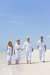 Four People, Two Seniors, Family Couples, Walking On Beach
