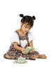 girl sitting on floor and counting money