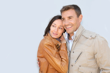 Portrait of loving couple with jackets on