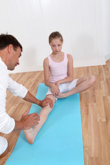 Physiotherapist with young girl