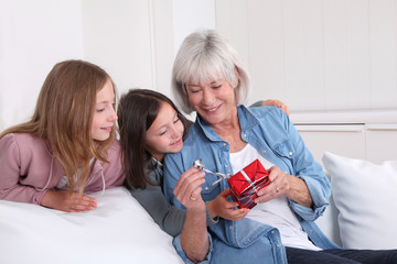 Girls offering present to grandmother