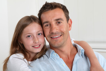 Portrait of happy father and young girl