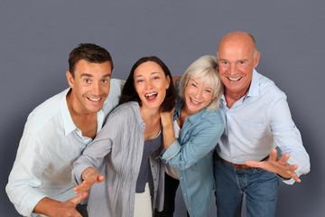 Portrait of happy couple with parents