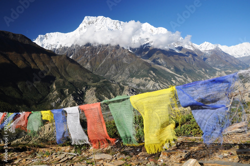 Annapurna peak with colorful prayer flags,  Nepal