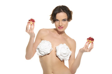 sexy woman with cream on his chest and pastry
