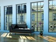 Wohndesign - schwarzes Ledersofa im Loft