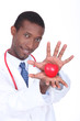Doctor holding a plastic heart in his hands