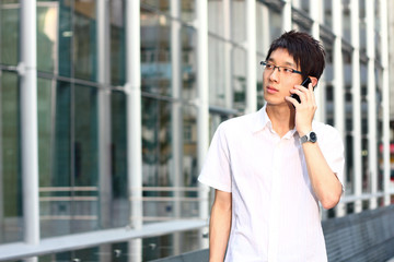 businessman talks with a mobile phone