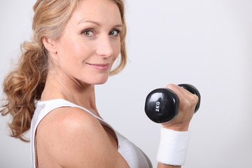 portrait of a woman with dumbbell
