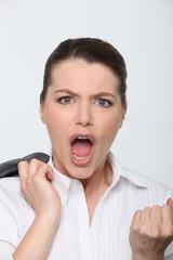 Businesswoman clenching fist