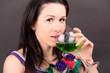 Постер, плакат: Красивая девушка улыбается и пьет из бокала напиток