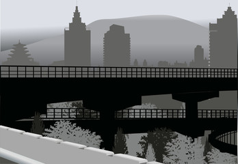 bridge in grey city near mountain