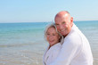 Portrait of senior couple relaxing on a resort beach