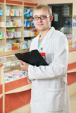 Pharmacy specialist in drugstore poster